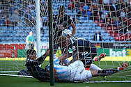 a scuffle breaks out in the goal net after Thomas Ince of Derby County (l on ground) scores his teams 4th goal. Skybet football league championship match, Huddersfield Town v Derby county at the John Smith's stadium in Huddersfield, Yorkshire on Saturday 18th April 2015.<br /> pic by Chris Stading, Andrew Orchard sports photography.
