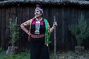Juana Calfunao Paillalef,  a female Lonko, leader and certainly one of the most outspoken defenders of the Mapuche cause stands in front of her Ruka,  the traditional circular wood and straw hut on her ancestral land. Having being inprisoned several times and in all for more then four years, has become an important symbol for the resistance of her indigenous people. She is internationally known and admired both at home and abroad, though her many enemies inside the Chilean state consider her to be a terrorist. She and her family are constantly threatened  and intimidated by the police. They have suffered multpile physical and verbal aggressions over the years as well and continually be under surveillance. Unbowed she continues her resisitance fight, Araucania, Chile. February 14, 2018.