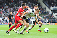Blackburn Rovers' Ben Marshall vies for possession with Derby County's Alex Pearce<br /> <br /> Photographer Chris Vaughan/CameraSport<br /> <br /> The EFL Sky Bet Championship - Derby County v Blackburn Rovers  - Saturday 24th September 2016 - iPro Stadium - Derby<br /> <br /> World Copyright © 2016 CameraSport. All rights reserved. 43 Linden Ave. Countesthorpe. Leicester. England. LE8 5PG - Tel: +44 (0) 116 277 4147 - admin@camerasport.com - www.camerasport.com