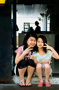 Portrait of Chinese sisters working for their family in a Chinese restaurant on the Panama Canal.
