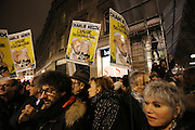 """Demonstrators hold front covers of Charlie Hebdo newspapers during a massive public demonstration which took place in Place de la Republique, in central Paris, France; the evening after armed gunmen attacked the offices of Charlie Hebdo, killing twelve people, including the editor and celebrated cartoonists; four more are in critical condition. It is the dealiest terror attack in France for over fifty years. Charlie Hebdo is a satirical publication well known for its political cartoons. <br /><br />As a solidarity actions with the deaths at Charlie Hebdo many placards read """"Je suis Charlie"""" translating as """"I am Charlie (Hebdo)"""". Demonstrators held aloft pens, brushes and crayons, symbolizing the profession of journalists and cartoonists who were killed. Many pens were placed in a shrine with candles in the square"""