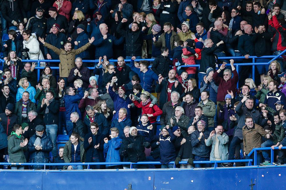 Burnley fans celebrate after their side score an equalising goal to make the score 1-1<br /> <br /> Photographer Craig Mercer/CameraSport<br /> <br /> Football - Barclays Premiership - Chelsea v Burnley - Saturday 21st February 2015 - Stamford Bridge - London<br /> <br /> © CameraSport - 43 Linden Ave. Countesthorpe. Leicester. England. LE8 5PG - Tel: +44 (0) 116 277 4147 - admin@camerasport.com - www.camerasport.com