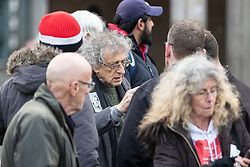 © Licensed to London News Pictures. 12/12/2020. Manchester, UK. Piers Corbyn arrives as crowd gathers with signs for North Unites protest in Piccadilly Gardens, Manchester. Piers Corbyn is expected to make a speech later. Photo credit: Kerry Elsworth/LNP