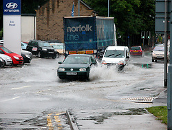 Cars drive through the flooding on The Common Ecclesfield Sheffield .15th June 2007.Image COPYRIGHT Paul David Drabble.