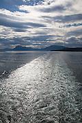 Ship's wake of Hurtigruten ferry sea between Harstad and Stokmarknes, Norway