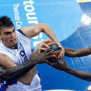 Anadolu Efes's Dario Saric (2ndL) during their Gloria Cup Basketball Tournament match Anadolu Efes between Olympiacos at Ulker Sports Arena in istanbul Turkey on Tuesday 23 September 2014. Photo by Aykut AKICI/TURKPIX