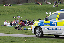 © Licensed to London News Pictures. 31/03/2021. London, UK. Members of the public picnic and enjoy the warm weather as police patrol in Greenwich Park in South East London. Temperatures are expected to rise with highs of 22 degrees forecasted for parts of London and South East England today . Photo credit: George Cracknell Wright/LNP