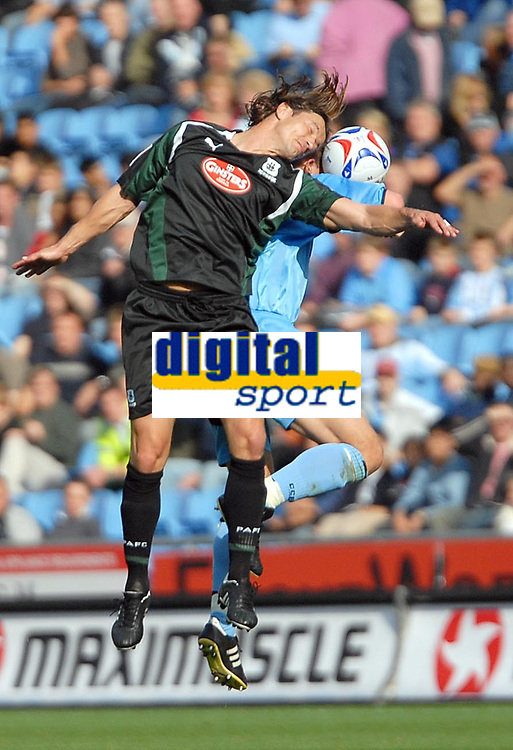 Photo: Ed Godden.<br />Coventry City v Plymouth Argyle. Coca Cola Championship. 30/09/2006. Stephen Hughes (hidden) is met by Plymouth's Lilian Nalis in the air.