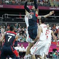 31 July 2012: USA Carmelo Anthony goes for the layup against Tunisia Salah Mejri during 110-63 Team USA victory over Team Tunisia, during the men's basketball preliminary, at the Basketball Arena, in London, Great Britain.