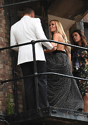 David Walliams and Amanda Holden return inside after waving to fans from a balcony at the Hammersmith Apollo, London, ahead of the final of Britain's Got Talent.