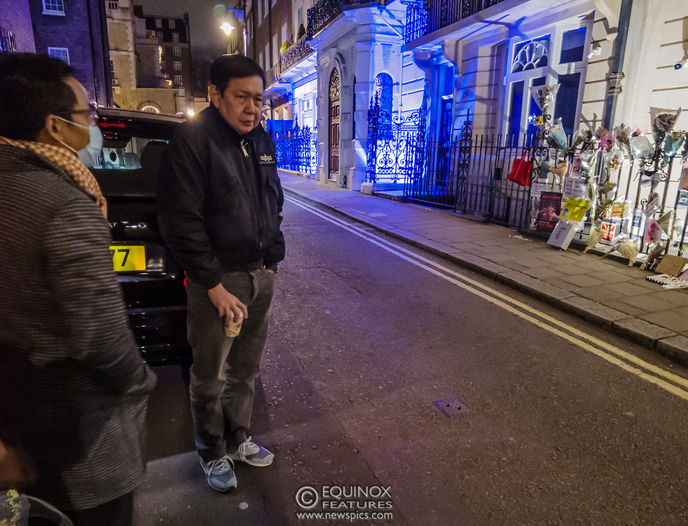 London, United Kingdom - 7 April 2021<br /> Myanmar's UK ambassador, Kyaw Zwar Minn waits outside the Myanmar embassy with his diplomatic car after being refused entry. It is claimed that this was orchestrated by his deputy, Chit Win with the assistance of the military attaché. The ambassador has called it 'a kind of coup'.<br /> (photo by: EQUINOXFEATURES.COM)<br /> Picture Data:<br /> Photographer: Equinox Features<br /> Copyright: ©2021 Equinox Licensing Ltd. +443700 780000<br /> Contact: Equinox Features<br /> Date Taken: 20210407<br /> Time Taken: 22075800<br /> www.newspics.com<br /> <br /> *Editor Notes:<br /> Panoramic Image consisting of image sequence taken over a few seconds.<br /> *Content is supplied subject to the rights usage terms below in addition to our standard terms and conditions*