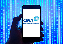 Person holding smart phone with CMA logo displayed on the screen. EDITORIAL USE ONLY