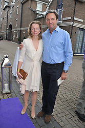 HELEN ASPREY and NIGEL HAWKINS at a party to celebrate the launch of Bentley's The Collection held at 6 Square Rigger Row, Plantation Wharf, York Road, London SW11 on 25th June 2012.