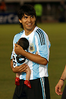 BUENOS AIRES, ARGENTINA - MARCH 28, 2009.<br /> 2010 FIFA World Cup qualifying Soccer match between ARGENTINA and VENEZUELA in the River Plate Stadium.<br /> Here Argentine SERGIO KUN AGUERO with his son BENJAMIN. WHo its a grand son of DIEGO MARADONA.<br /> © PikoPress