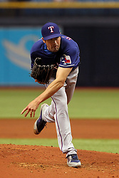April 18, 2018 - St. Petersburg, FL, U.S. - ST. PETERSBURG, FL - APR 18: Cole Hamels (35) of the Rangers delivers a pitch to the plate during the MLB regular season game between the Texas Rangers and the Tampa Bay Rays on April 18, 2018, at Tropicana Field in St. Petersburg, FL. (Photo by Cliff Welch/Icon Sportswire) (Credit Image: © Cliff Welch/Icon SMI via ZUMA Press)