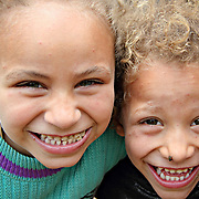 Two girls grin for the camera. Dahab Island, Cairo.