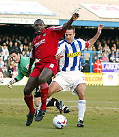 Photo: Chris Ratcliffe.<br />Colchester United v Southend United. Coca Cola League 1. 04/03/2006.<br />Shaun Goater (L) of Southend tussles with Karl Deguid of Colchester.