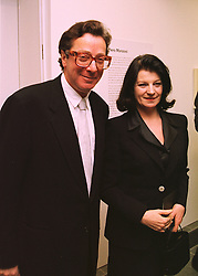 LORD & LADY SAATCHI at a reception in London on 12th March 1998.MGA 44