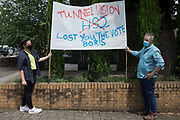 Local residents and anti-HS2 campaigners stand alongside a protest banner referring to the recent Chesham and Amersham by-election result on 25th June 2021 in Amersham, United Kingdom. Many commentators have identified dissatisfaction with HS2 as a significant factor in the overturning of a 16,000 Conservative majority in the by-election, which Liberal Democrat candidate Sarah Green won by 8,028 votes.