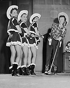Y-540602. Cowgirl band. Daughters of the Nile dancers, June 2, 1954, Masonic Temple, Portland Oregon. Mrs. A. B. Bremmer(right) was emcee; dancers (from left) are Mrs. Arthur Kohanek, Mrs. Graham Killam and Mrs. Frank Keller
