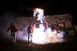 © Licensed to London News Pictures. 04/11/2017. Lewes, UK. People in costume set off fireworks as they take part in celebrations for the traditional Lewes Bonfire Night celebrations on Saturday, 4 November, 2017. Thousands of people attend the parade through the narrow streets of Lewes and burn effigies to celebrate Guy Fawkes nightalso known as bonfire night, the anniversary of the gunpowder plot to blow up the Houses of Parliament in London. Photo credit: London News pictures