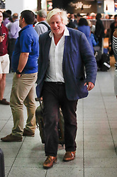© Licensed to London News Pictures. 11/08/2018. Crawley, UK. BORIS JOHNSON is seen returning to Gatwick Airport after a short visit to Italy. The former foreign secretary has been criticised for language he used in a national newspaper column to describe women wearing the burka. Photo credit: London News Pictures