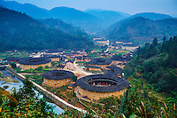 "Chine, Province du Fujian, village de Hekeng, maison forteresse en terre et en bois où logent les membres d'une meme famille de l'ethnie Hakka, inscrit au patrimoine mondial de l'Unesco // China, Fujian province, Hekeng village, Tulou mud house. well known as the Hakka Tulou region, in Fujian. In 2008, UNESCO granted the Tulou ""Apartments"" World Heritage Status, siting the buildings as exceptional examples of a building tradition and function exemplifying a particular type of communal living and defensive organization. The Fujian Tulou is ""the most extraordinary type of Chinese rural dwellings"" of the Hakka minority group and other people in the mountainous areas in southwestern Fujian."