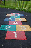 Hopscotch game in park playground in suburban Dublin Ireland after rainfall