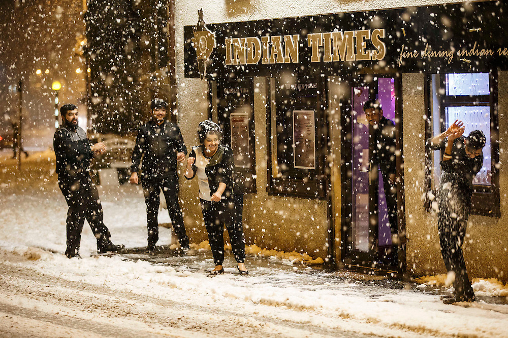 Staff at the Indian Times in Stonehouse, South Lanarkshire enjoy a snowball fight during the late afternoon. Picture Robert Perry 8th Jan 2015<br /> <br /> Must credit photo to Robert Perry<br /> FEE PAYABLE FOR REPRO USE<br /> FEE PAYABLE FOR ALL INTERNET USE<br /> www.robertperry.co.uk<br /> NB -This image is not to be distributed without the prior consent of the copyright holder.<br /> in using this image you agree to abide by terms and conditions as stated in this caption.<br /> All monies payable to Robert Perry<br /> <br /> (PLEASE DO NOT REMOVE THIS CAPTION)<br /> This image is intended for Editorial use (e.g. news). Any commercial or promotional use requires additional clearance. <br /> Copyright 2014 All rights protected.<br /> first use only<br /> contact details<br /> Robert Perry     <br /> 07702 631 477<br /> robertperryphotos@gmail.com<br /> no internet usage without prior consent.         <br /> Robert Perry reserves the right to pursue unauthorised use of this image . If you violate my intellectual property you may be liable for  damages, loss of income, and profits you derive from the use of this image.