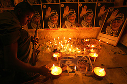 Yasser Arafat's personal security detail, Force 17, mourn the loss of their leader, Gaza, Palestinian Territories, Nov. 11, 2004. Arafat died in a Paris hospital at the age of 75.