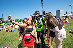 Police with fans. Fans in the main arena on Friday 29th June at TRNSMT 2018.