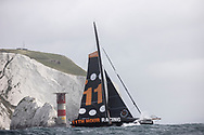 COWES, ENGLAND - AUGUST 08: The 49th edition of the Rolex Fastnet Race starting from the Royal Yacht Squadron line in Cowes, UK , rounding the 'Fastnet Rock' in Southern Ireland and then finishing in Cherbourg. France.Pictures of the '11th Hour Racing' IMOCA Open60 skippered by Simon Fisher with co skipper Justine Mettraux shown here passing the Needles lighthouse. August 8, 2021 in Cowes, England. (Photo by Lloyd Images/Getty Images)