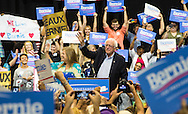 July 26, 2015 Kenner Louisiana, Bernie Sanders wife, Jane Sanders, walks him to the podium and gives him a kiss before leaving the stage as he begins a rally at the Pontchartrain Center in Kenner. 4500 people turned out to hear him speak on Sunday night.