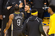 Golden State Warriors forward Andre Iguodala (9) celebrates with Golden State Warriors guard Stephen Curry (30) during Game 2 of the Western Conference Quarterfinals against the San Antonio Spurs at Oracle Arena in Oakland, Calif., on April 16, 2018. (Stan Olszewski/Special to S.F. Examiner)