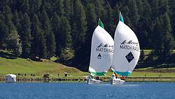 Ian Williams, GBR, skipper of Team GAC Pindar, (left) beats  Jerome Clerc, SUI, skipper of Team CER Geneve, in the round robin of the St Moritz Match Race 2010. World Match Racing Tour. St Moritz, Switzerland. 1st September 2010. Photo: Ian Roman/WMRT.