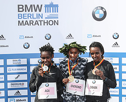 BERLIN, Sept. 16, 2018  Women's gold medalist Kenya's Gladys Cherono (C), poses for photos with silver medalist Ethiopia's Ruti Aga (L) and bronze medalist Ethiopia's Tirunesh Dibaba during the award ceremony of the Berlin Marathon 2018 in Berlin, capital of Germany, on Sept. 16, 2018. The Berlin Marathon 2018 kicked off in Berlin on Sunday. Eliud Kipchoge from Kenya won the men's title with a new world record of 2:01:39. Women's title fell on Kenya's Gladys Cherono with a result of 2:18:11. (Credit Image: © Shan Yuqi/Xinhua via ZUMA Wire)