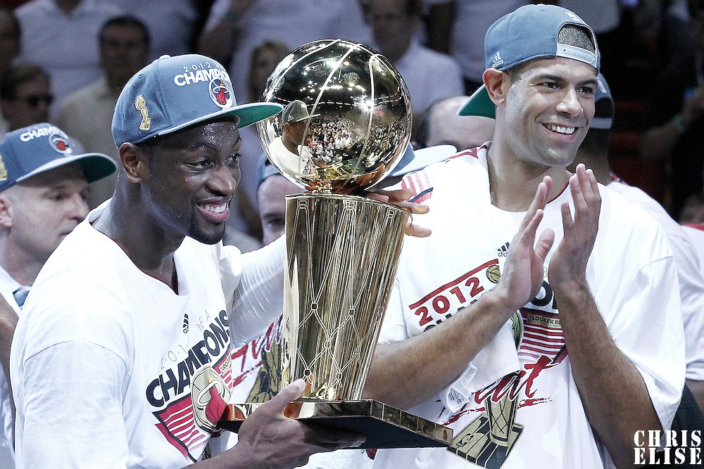 21 June 2012: Miami Heat shooting guard Dwyane Wade (3) celebrates holding the NBA Championship trophy next to Miami Heat small forward Shane Battier (31) after the Miami Heat 121-106 victory over the Oklahoma City Thunder, in Game 5 of the 2012 NBA Finals, at the AmericanAirlinesArena, Miami, Florida, USA. The Miami Heat wins the series 4-1.
