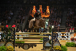 Great Britain's John Whitaker riding Madinah competes in the Snowflake stakes during day four of the London International Horse Show at London Olympia.