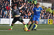 Bristol Rovers defender Tom Lockyer (4) just stopping a through ball to AFC Wimbledon striker Lyle Taylor (33) during the EFL Sky Bet League 1 match between AFC Wimbledon and Bristol Rovers at the Cherry Red Records Stadium, Kingston, England on 17 February 2018. Picture by Matthew Redman.