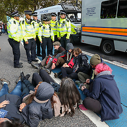 © Licensed to London News Pictures. 15/10/2019. London, UK. Extinction Rebellion protesters occupy Millbank near the MI5 building, as police make arrests. Activists continue to occupy roads around Westminster and the City for the 9th day. Photo credit: Alex Lentati/LNP