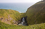 The Devil's Frying Pan coastal feature formed by the collapse and erosion of a large sea cave near Cadgwith on the Lizard Peninsula, Cornwall, England
