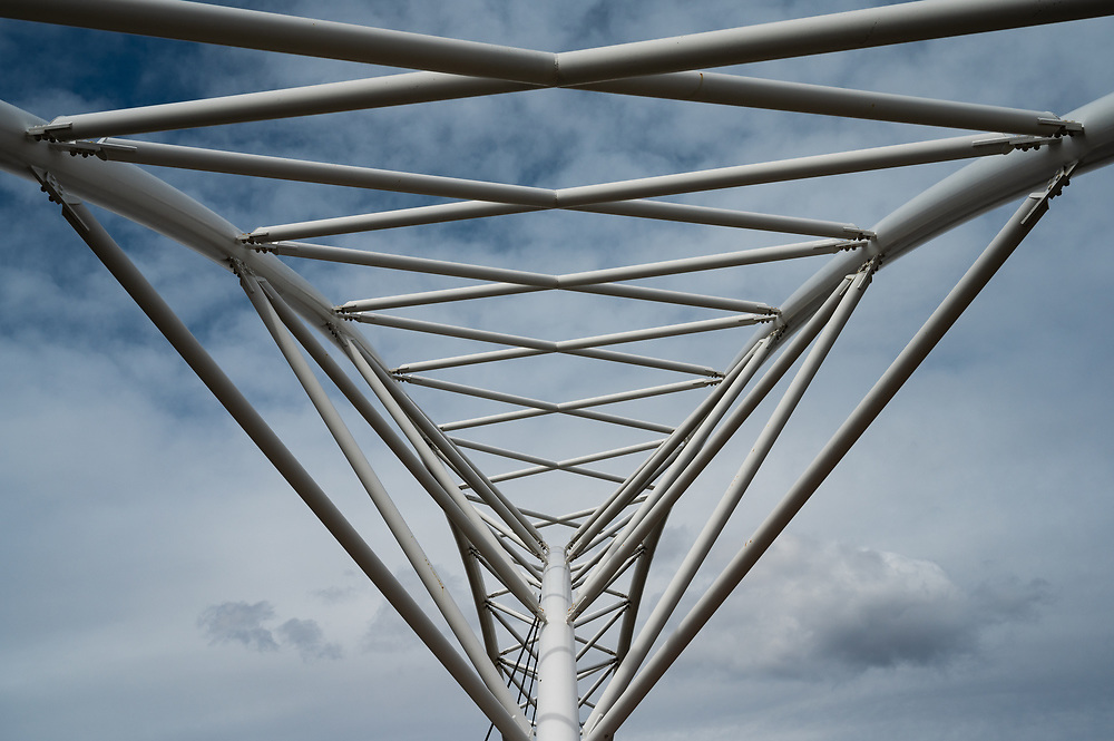 The 16th Street walking bridge over I25 in Denver, Colorado is supported by a fascinating array of metal beams.