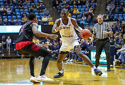 Dec 22, 2018; Morgantown, WV, USA; West Virginia Mountaineers forward Lamont West (15) makes a move during the second half against the Jacksonville State Gamecocks at WVU Coliseum. Mandatory Credit: Ben Queen-USA TODAY Sports