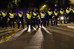 London, November 5th 2016. Anti-capitalists and anarchists participate in the Million Mask March, an annual event that happens on November 5th each year in cities across the world, as part of a protest against the establishment. Many of the protesters wear Guy Fawkes masks, often associated with the internet activism group Anonymous. PICTURED: Police form a cordon across Victoria Street.