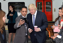 © Licensed to London News Pictures. 01/06/2015. <br /> LONDON, UK. Boris Johnson (R) welcomes expansion of TfL rail services. The Mayor of London visits Enfield Town station to meet staff ahead of TfL taking on responsibility of additional stations and a number of rail services out of Liverpool Street station, London, Monday 01 June 2015. Photo credit : Hannah McKay/LNP