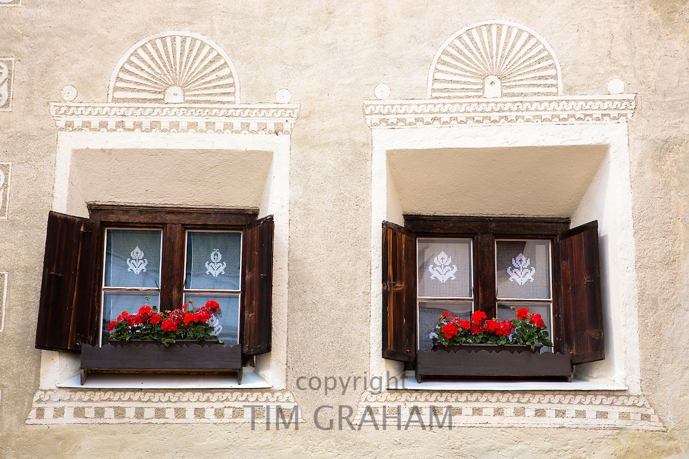 Detail of window  in the Engadine Valley in village of Guarda with old painted stone 17th Century houses, Switzerland