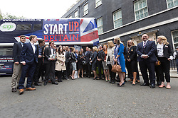 © Licensed to London News Pictures. 23/06/2015. London, UK. DAVID CAMERON with entrepreneurs at the launch of the Start-Up Britain campaign routemaster bus in Downing Street, London with Prime Minister, David Cameron. Over five weeks the routemaster bus will visit 30 towns and cities - including Aberdeen, Inverness, Swansea York and Leeds - and aim to engage with 15,000 individuals through workshops and networking events, making them aware of the assistance Start-Up Britain can offer. Photo credit : Vickie Flores/LNP
