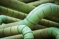 Green pipes run through a production unit within a refinery in Baton Rouge, La.