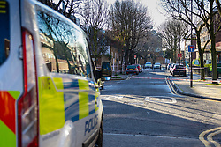 A police cordon surrounds the streets in the area where a 17 year-old boy died after being stabbed on Caledonian Road, Islington, North London. London, January 30 2019.