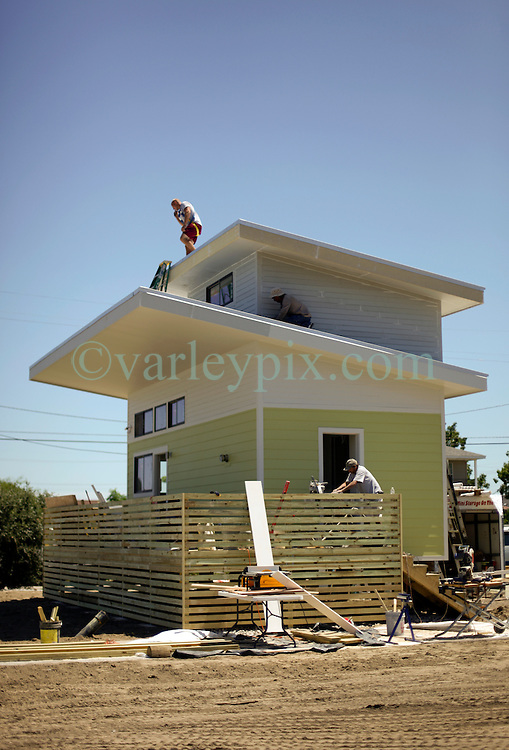 26 August 2015. New Orleans, Louisiana. <br /> Hurricane Katrina revisited. <br /> Rebuilding the Lower 9th Ward. <br /> Another eco friendly 'Make it Right' house on Tennessee Street makes shape.  'Make it Right' homes inspired by actor Brad Pitt continue to provide hope for the rebirth of the community following the devastation of hurricane Katrina a decade earlier.<br /> Photo credit©; Charlie Varley/varleypix.com.